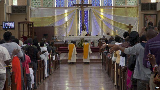 Kenyan Christians pray as they join a morning service at Holy Family Basilica in Nairobi, Kenya on 5 April 2015