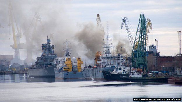 Smoke is seen rising from the Russian nuclear submarine Orel on 7 April 2015