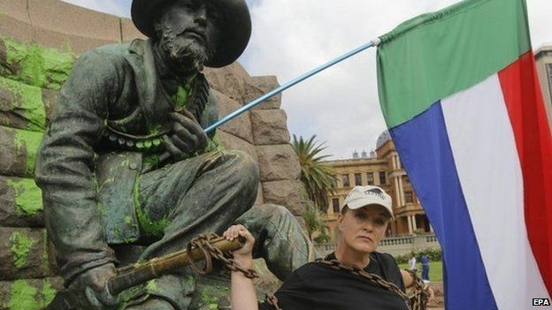 South African singer and Afrikaner activist, Sunette Bridges, chains herself to the statue of Afrikaner hero Paul Kruger in central Pretoria, South Africa, 8 April 2015
