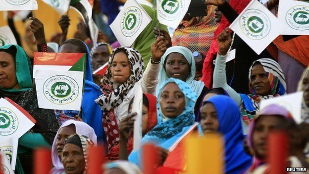 Supporters wave National Congress party (NCP) flags during a campaign launch for Sudanese President and NCP candidate Omar al-Bashir ahead of the 2015 elections at Marikh Stadium in Omdurman