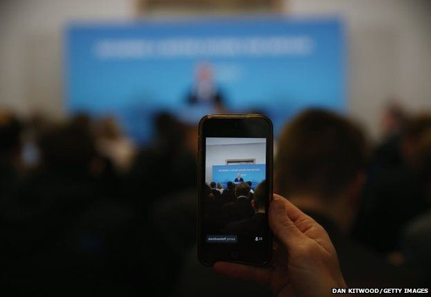 A reporter live streams via a twitter as Defence Secretary Michael Fallon gives a press conference