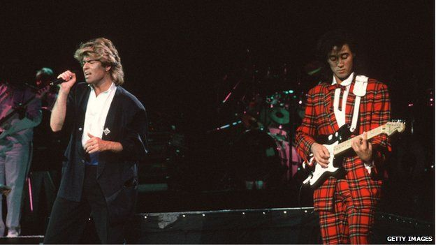 George Michael (left) and Andrew Ridgeley, of the pop group Wham playing a concert at Beijing's People's Stadium on 7 April 1985.