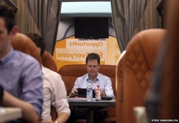 Leader of the Liberal Democrats Nick Clegg works on the battle bus after a visit to Bodmin