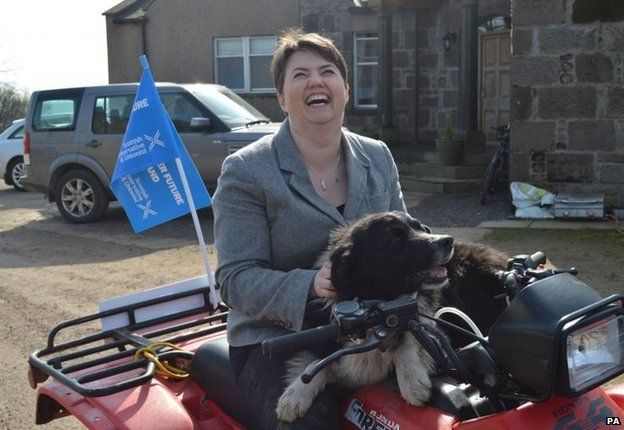 Ruth Davidson with Rio the Border Collie on a Quad Bike at Clochnahill Farm, Stonehaven