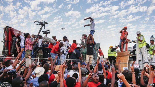 The statue of one of apartheid's architects Cecil John Rhodes is removed as thousands cheer from the University of Cape Town