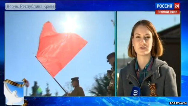 Man with a red flag shown on Russian TV