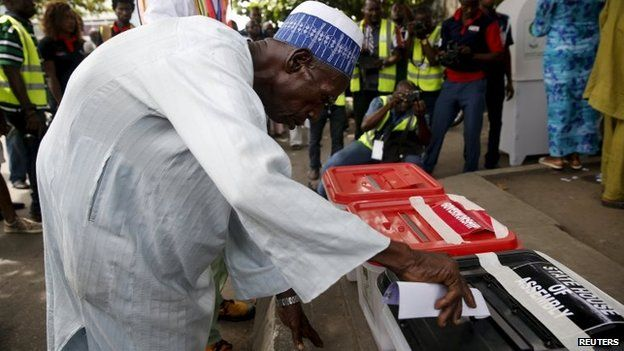 A man casts his vote during the governorship election in Apapa district in Lagos, 11 April 2015