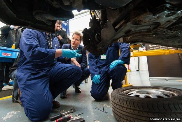 Liberal Democrat leader Nick Clegg speaks with apprentice mechanics during a visit to Mid- Kent College in Maidstone, Kent