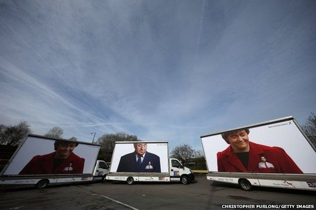 A convoy of Conservative Party election posters arrives at the venue where Ed Miliband will launch the 2015 election manifesto