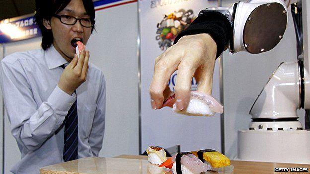 Robotic hand serves sushi