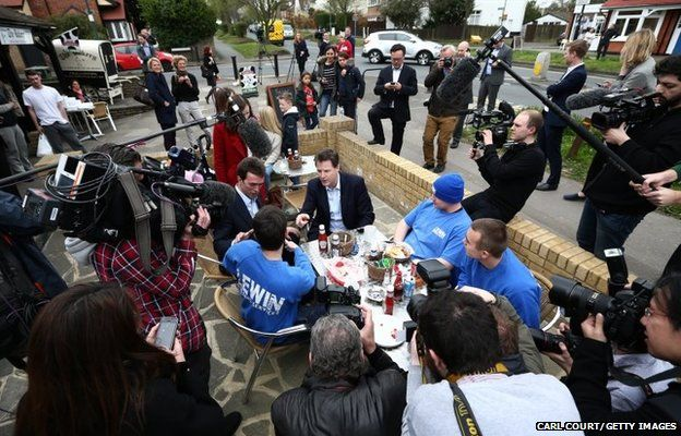 Liberal Democrat leader Nick Clegg (centre) chats with builders during a visit to a cafe on April 13, 2015 in Carshalton, England