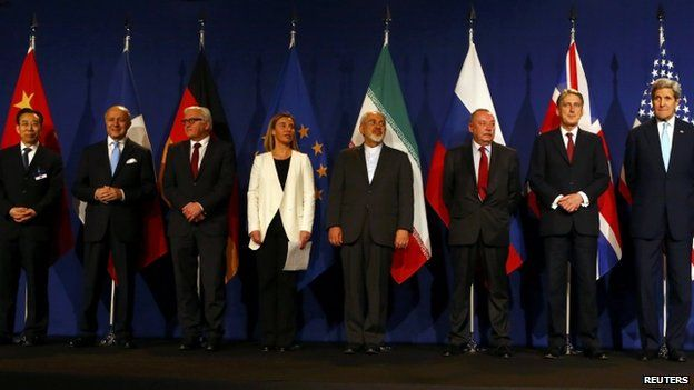 """Chinese ambassador Wu Hailong, French Foreign Secretary Laurent Fabius, German Foreign Minister Frank-Walter Steinmeier, EU foreign policy chief Federica Mogherini, Iran""""s Foreign Minister Javad Zarif, Alexey Karpov, the deputy director of the department for nonproliferation and arms control of the Ministry of Foreign Affairs of Russia, British Foreign Secretary Philip Hammond and U.S. Secretary of State John Kerry (R-L) pose in Lausanne April 2, 2015"""