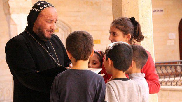 Father Yusuf, a monk in Mar Mattai with refugee children