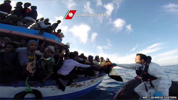 Italian Guardia Costiera takes part in a rescue operation of migrants off the coast of Sicily on 13 April 2015.