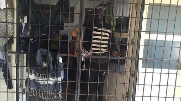 A man pictured behind bars
