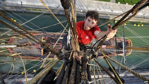 A volunteer crew member climbing the mast of the replica of the French frigate Hermione (June 2014)