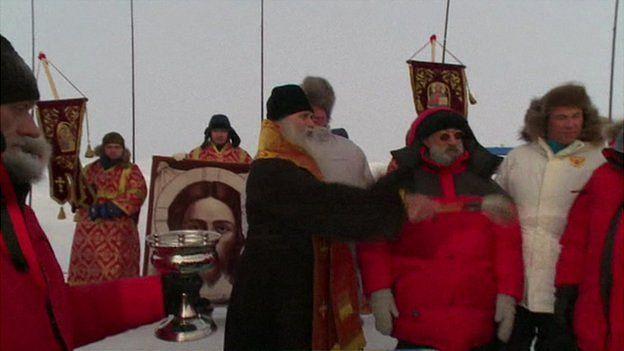 Russian Orthodox priest blesses North Pole station (APTN screengrab)