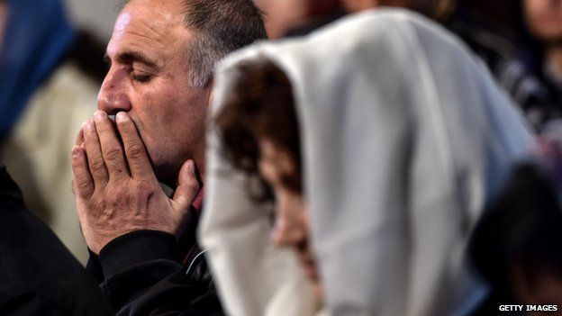 A man prays during a religious service at the cathedral in Etchmiadzin, outside Yerevan, on 23 April 2015