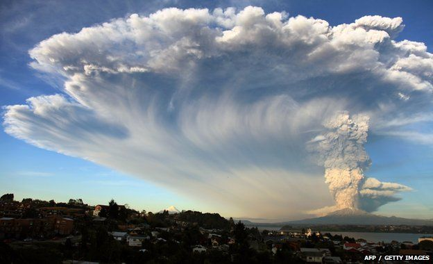 View from Puerto Montt, southern Chile, of a high column of ash and lava spewing from the Calbuco volcano, 22 April 2015