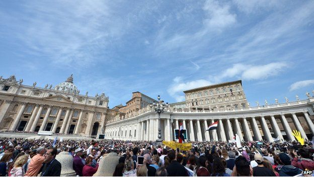 A general view shows Pope Francis addressing the crowd from the window of the apostolic palace overlooking St Peter's square