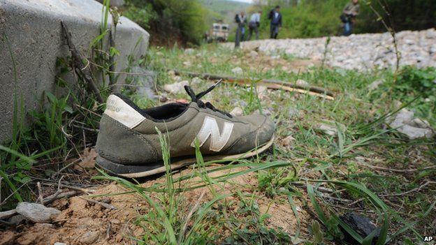 Shoe lies alongside rail track (25 April)