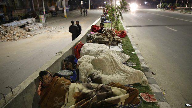 People sleep outside on a street a in Kathmandu, Nepal