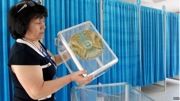 Official prepares a voting station in Astana