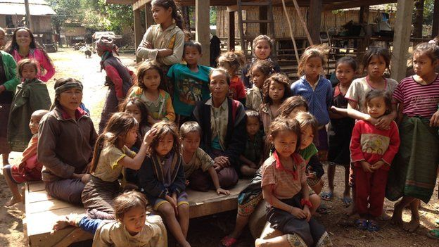 """Women and children from a remote village in Laos inhabited by the """"So"""" people"""