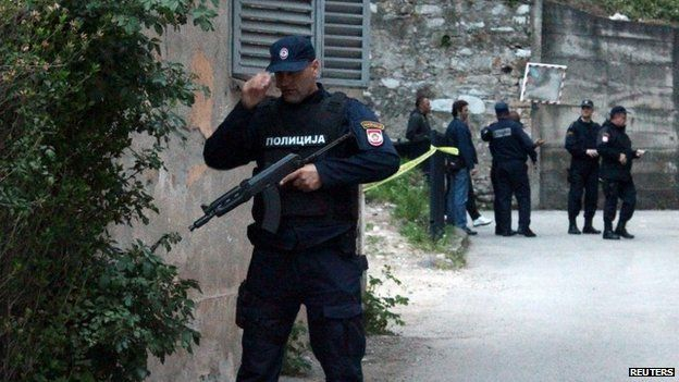 Members of special police take position in front of an attacked police station in Zvornik, April 27, 2015.