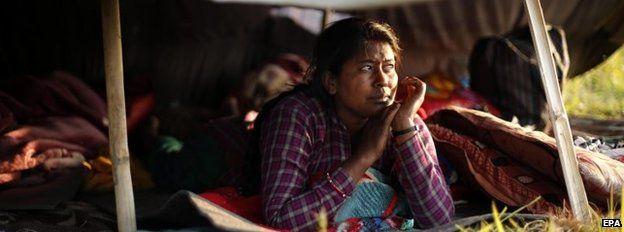 Woman in a tent in Kathmandu, Nepal (27 April 2015)