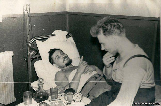 Leonid lying down talking to his friend Yuri Vereschagin