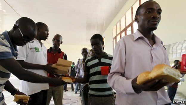 Students from a Burundi university queue to receive food rations as they camp outside the U.S. embassy in the capital Bujumbura, May 1, 2015