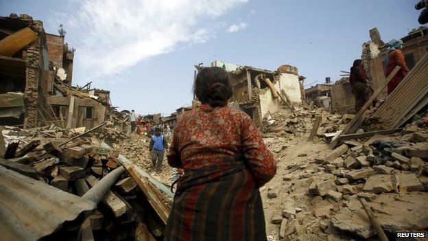 People works near the collapsed houses after last week's earthquake in Bhaktapur, Nepal May 2, 2015.