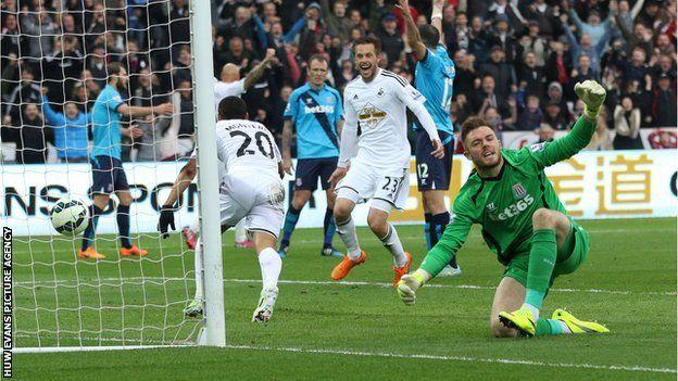 Swansea's Jefferson Montero wheels away to celebrate after scoring against Stoke