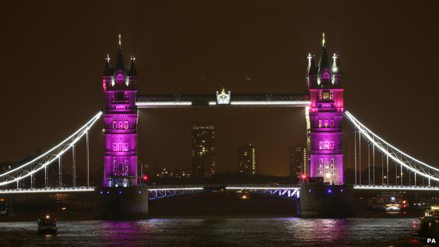 Tower Bridge lit in pink to mark the royal birth