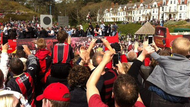 Supporters capture the bus on their phones