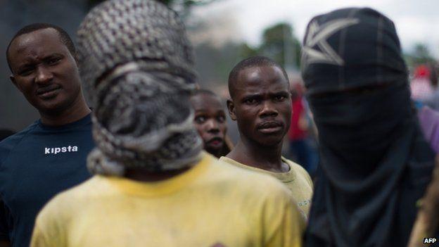 Protesters stand at a barricade in the Musaga neighbourhood of Bujumbura, Burundi, on May 5