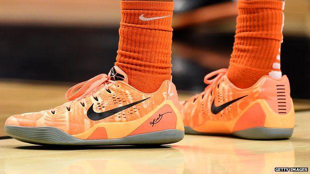 An Oregon State Beavers basketball player wearing Nike shoes