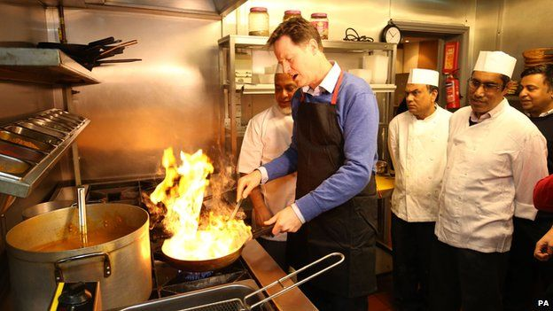 Nick Clegg helping out in the kitchen of a curry house in Cardiff