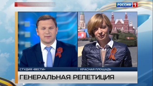TV presenters wearing ribbons of St George