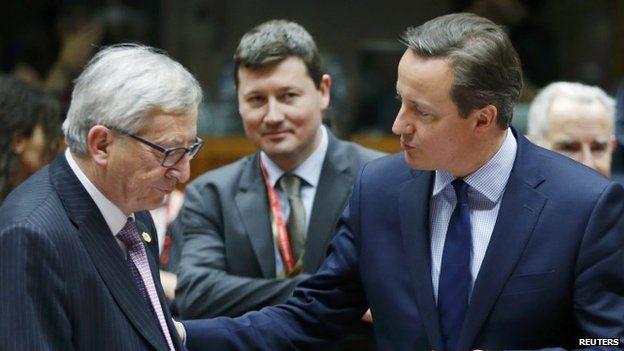 European Commission President Jean-Claude Juncker listens to Britain's Prime Minister David Cameron