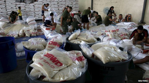Members of the Armed Forces of the Philippines help out volunteers repacking food rations for victims of Typhoon Noul at the Department of Social Welfare Development (DSWD) headquarters in Pasay city, south of Manila May 9, 2015