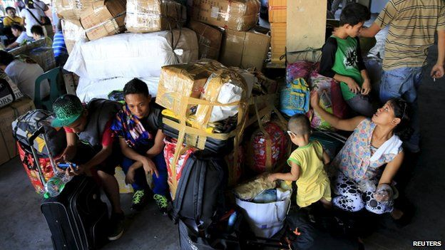 Stranded passengers guard their belongings while waiting at a bus terminal in Manila May 9, 2015