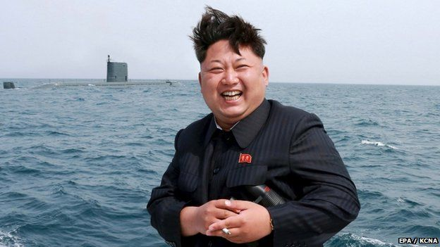 North Korean leader Kim Jong Un watches the test-fire of a strategic submarine underwater ballistic missile 09 May 2015.