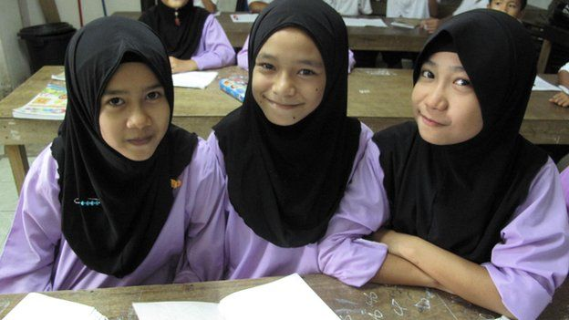 3 school girls in a classroom