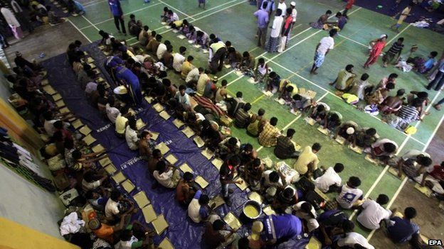 Rohingya refugees line up for breakfast in the sport stadium of Lhok Sukon, North Aceh, Sumatra, Indonesia, 11 May 2015.