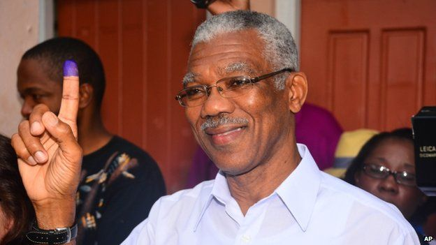 Presidential Candidate of the A Partnership for National Unity and Alliance For Change (APNU+AFC) David Granger displays his inked finger after voting at the Enterprise Primary School Georgetown Guyana, Monday, May 11, 2015