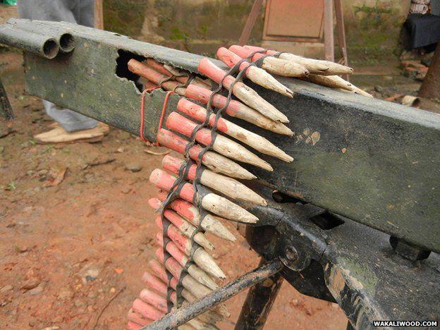Replica machine-gun and wooden bullets