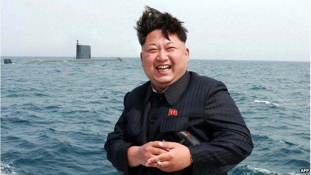 North Korea leader Kim Jong-un by a submarine at sea (9 May 2015)