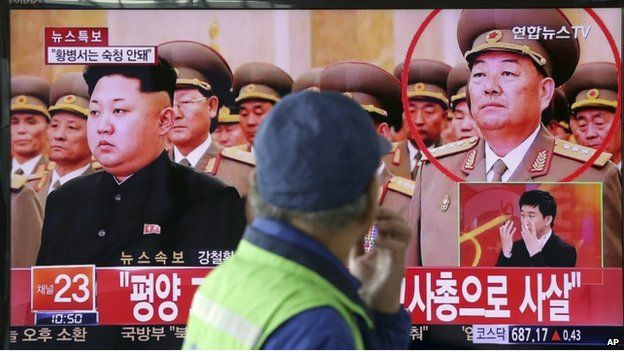 A man watches a TV news program reporting that People's Armed Forces Minister Hyon Yong-chol was killed by anti-aircraft gunfire, at Seoul Railway Station in Seoul, South Korea, Wednesday, 13 May 2015